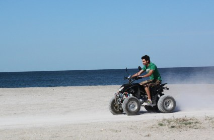 Driving ATV on Beach