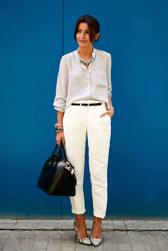 30 Chic Work Outfits to Wear this Summer: Fashion blogger 'Lovely Pepa' wearing a white blouse, a pearl necklace, white ankle pants, a black belt, snake print heels and a black structured bag. Work outfits, summer work outfits, office wear, business casual, fashion, street style, womens fashion, all white outfit.