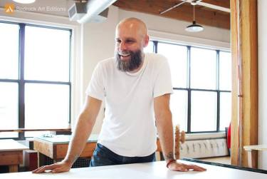 Tamarind Master Printer Aaron Shipps in the Bedrock studio.