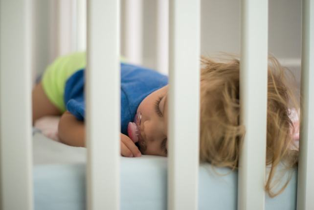 baby sleeping in crib