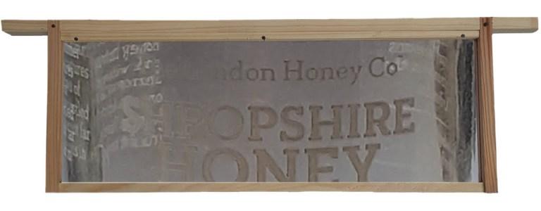LondonHOneyCompany label set inside hive frame