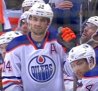 Hallsy and Ebs look on while Matt Hendricks writhes on the ice in pain after getting his balls puck smashed.