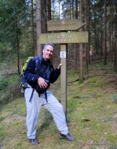 hiker near sign