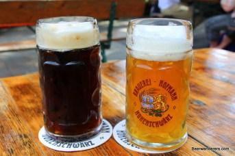 dark and unfilitered golden beers in mugs