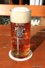 golden beer in mug with big head