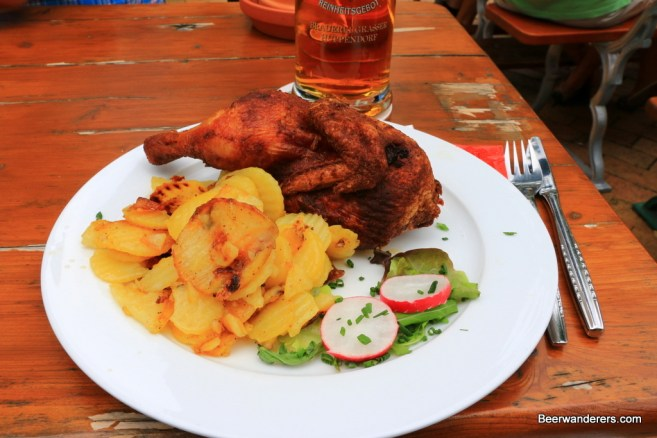 half a roast chicken with potatoes