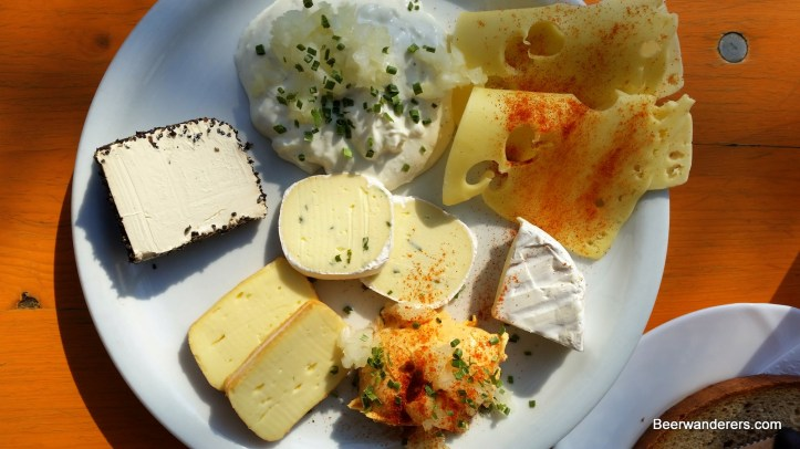 assorted cheeses on plate