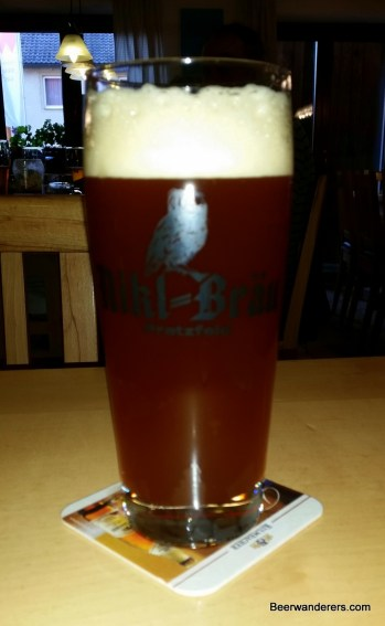 unfiltred ruddy beer in glass