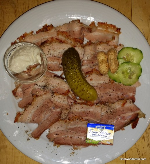 cold pork on plate with pickle