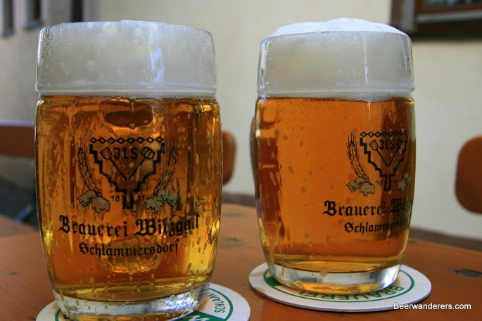 golden beer in two mugs