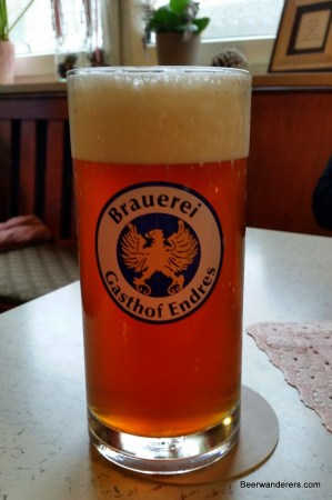 unfiltered beer in glass with big head