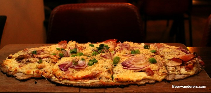 flat bread with melted cheese and ham