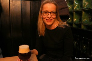 woman with dark beer