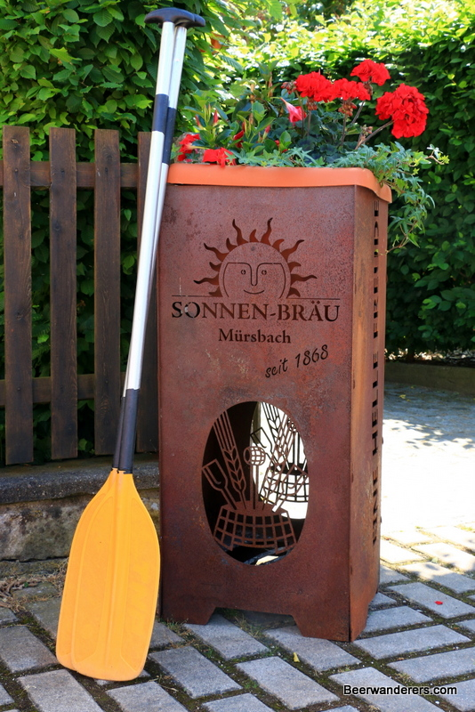 canoe paddle next to brewery sign