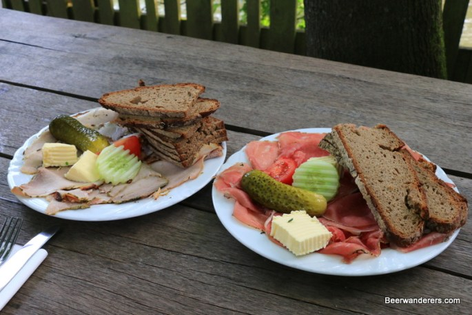 cold cuts with bread on plates