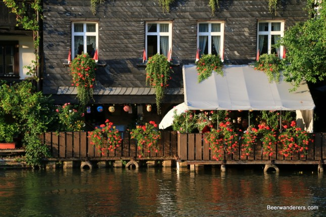 flowers on house on river