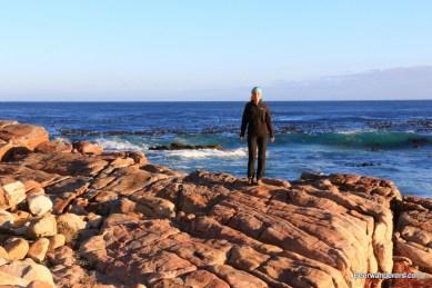girl on rocks ocean