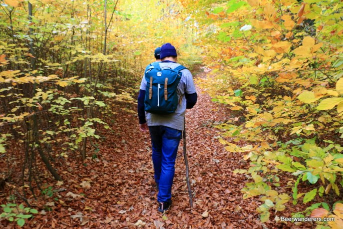 beer hikers on trail in autumn
