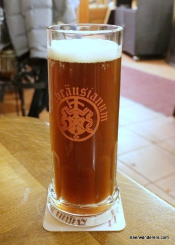 unfiltered brown beer in glass