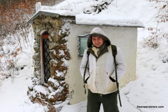 hiker at shrine in winter
