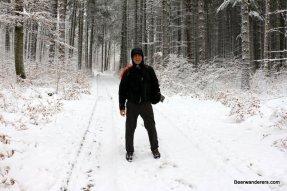 man hiking in winter