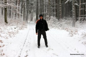 man hiking in winter