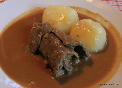 meat roll with dumplings on plate