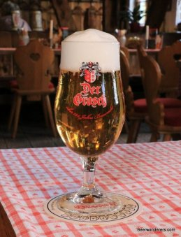yellow beer in stemmed glass