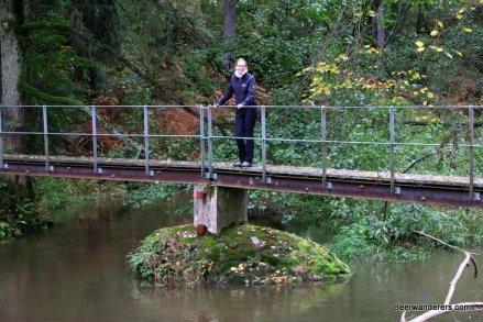 girl hiker on bridge