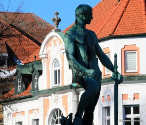 statue of man with sword
