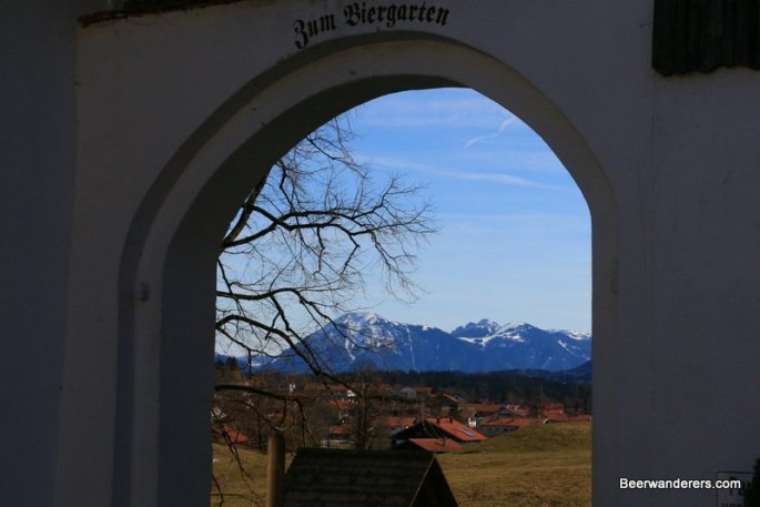 biergarten through entrance with mountains