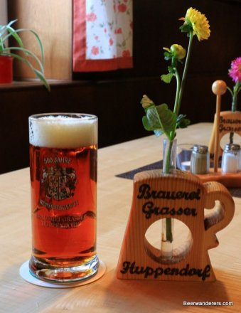 amber beer in mug with flowers
