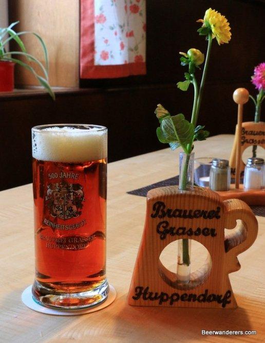 amber beer in mug with flowers