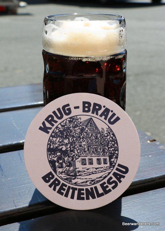 dark beer in mug with coaster