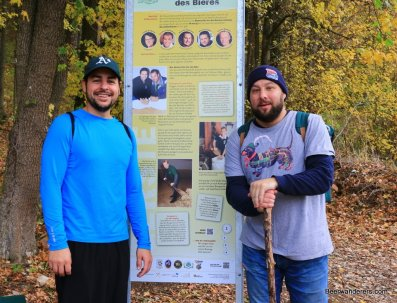 two hikers at sign