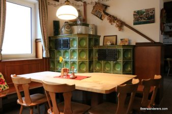 cozy old pub with green ceramic oven