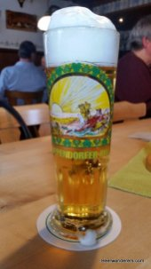 yellow beer in pils glass with big head