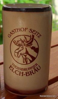 beer in ceramic mug with moose logo
