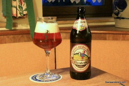 amber beer in glaass with bottle