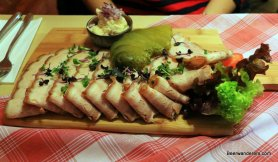 cold roast pork on wooden board