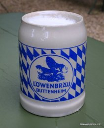 beer in ceramic mug with lion logo