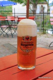 unfiltered amber beer in mug with huge head