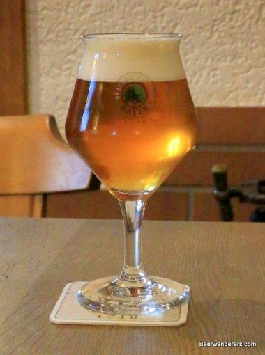 unfiltered golden beer in wine glass