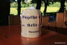 beer in ceramic mug with great head