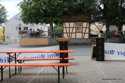 tables and benches with Biergarten view