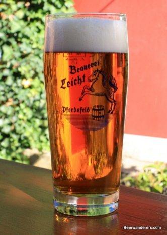 light amber beer in glass
