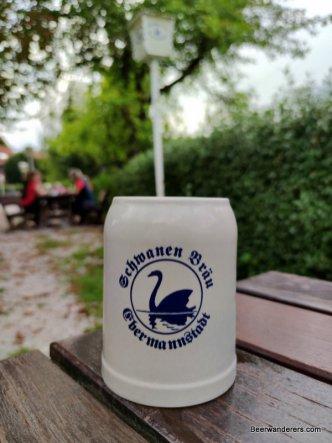 beer in ceramic mug with swan logo
