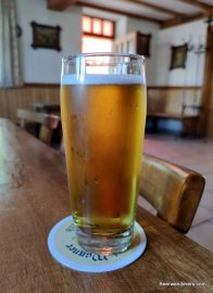 yellow beer in glass