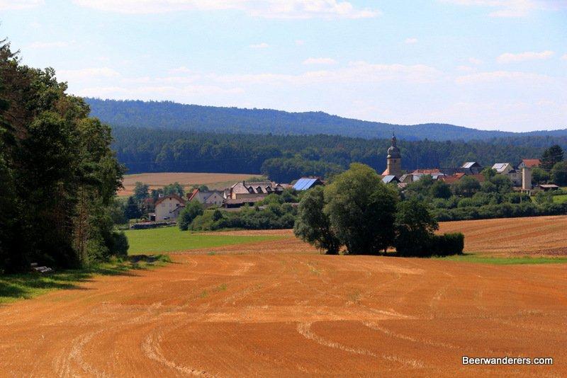 church tower across a field