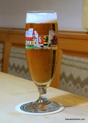 beer in Pils glass with log